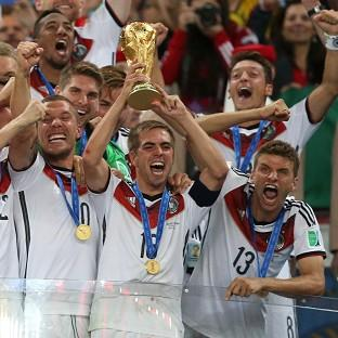 Philipp Lahm, pictured holding the World Cup trophy, has retired from international football