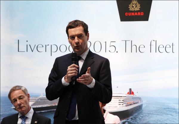 Chancellor George Osborne in Southampton, in front a of banner about Liverpool.
