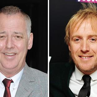 Michael Barrymore, left, and Rhys Ifans have settled their phone hacking claims against News Group Newspapers at the High Court in London