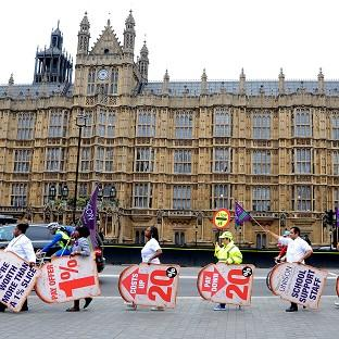 Public sector workers and members of the Unison union outside the Houses of Parliament during the last