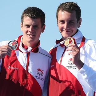 Alistair Brownlee, right, has warned brother Jonathan, left, he is not done yet