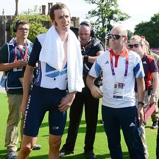 Sir Bradley Wiggins, left, and Dave Brailsford, right, remain in talks over a new Team Sky deal
