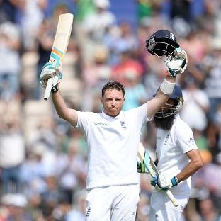 Ian Bell celebrates getting his century on day two