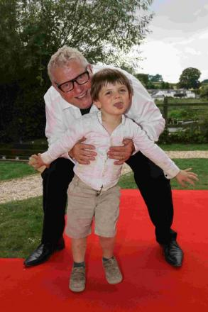 Guy Kremer with a small guest at his party