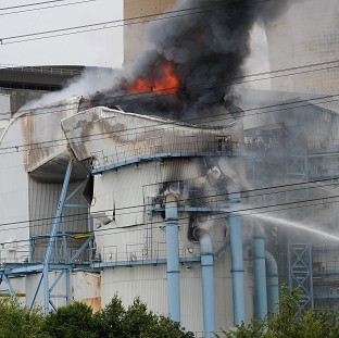 Huge blaze erupts at power station