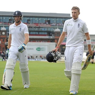 Joe Root, right, was unbeaten on 48 when the players left the field, with Jos Buttler 22no