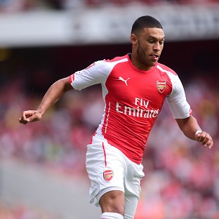 Alex Oxlade-Chamberlain believes Arsenal will carry the feel-good factor of winning last season's FA Cup into the new campaign