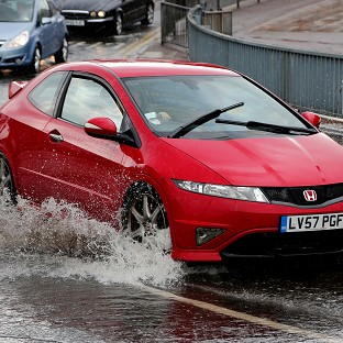 Heavy wind and rain batters Britain