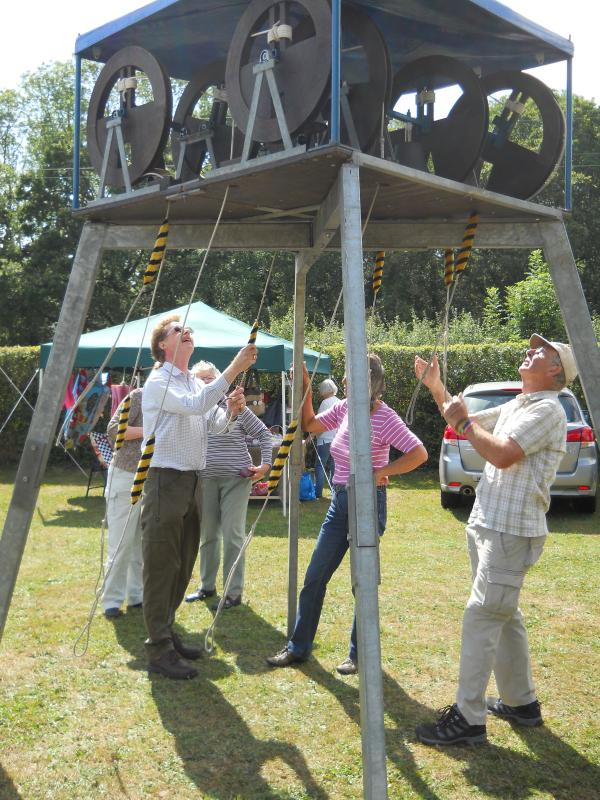 Lockerley and East Tytherley bellringers challeneged of fete-goers to have a go themselves on a mini ring of eight smal
