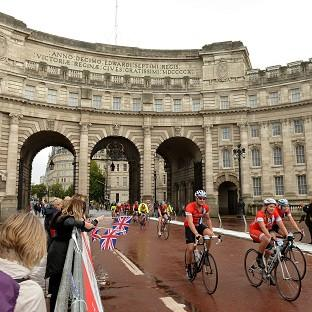Cyclists make their way through Admiralty Arch on The Mall in