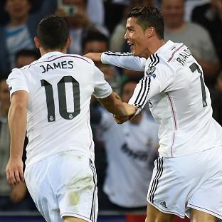 Cristiano Ronaldo, right, celebrates scoring his second goal at the Cardiff City Stadium