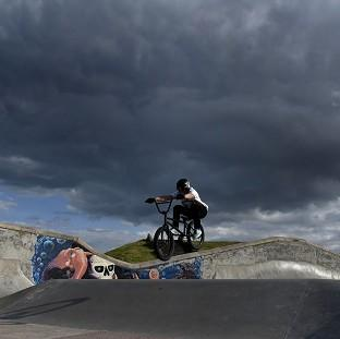 Storm clouds over Whitley Bay skate park as unseasonably cool temperatures announce the arrival of autumn