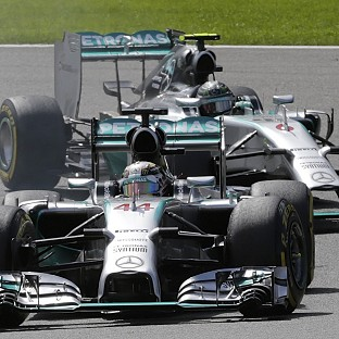Lewis Hamilton was hit by team-mate Nico Rosberg on lap two (AP)