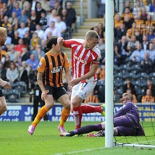 Ryan Shawcross, centre, scores Stoke's equaliser against Hull City at the KC Stadium