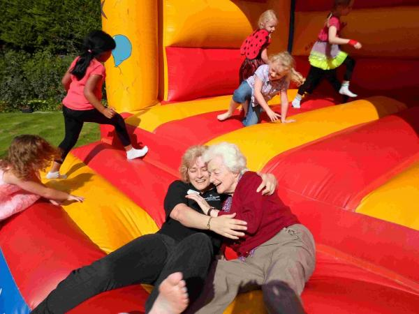Dementia care home hosts family fun day with Mickey Mouse