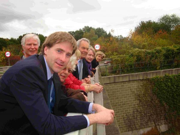Steve Brine with villagers on an M3 bridge