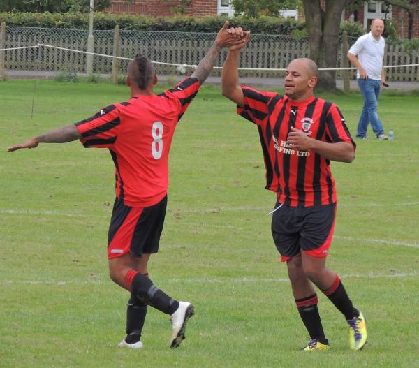 Dan Reynolds (right) celebrates on Saturday but was sent off on Tuesday