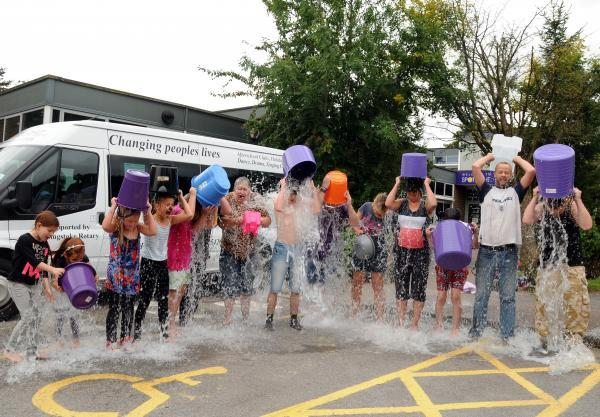 Volunteers, staff and users of the Popley Spotlight Centre take part in the Ice Bucket Challenge