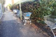 Problems caused by shoppers dumping trolleys in popular footpath