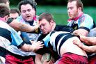 An Andover player crashes into Old Tonbridgians' defensive line