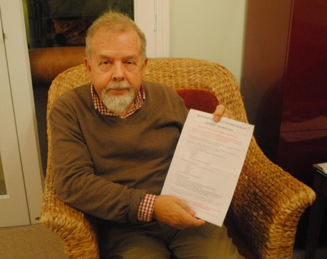 Michael Humphrey with the letter he received about the parking plans