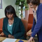 Andover Advertiser: EastEnders snaps show Denise hovering over adoption forms