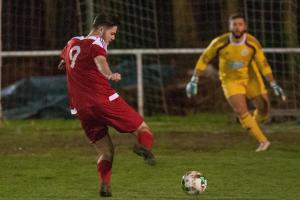 Will Grange puts Whitchurch 1-0 up during their thrilling derby with Andover Town