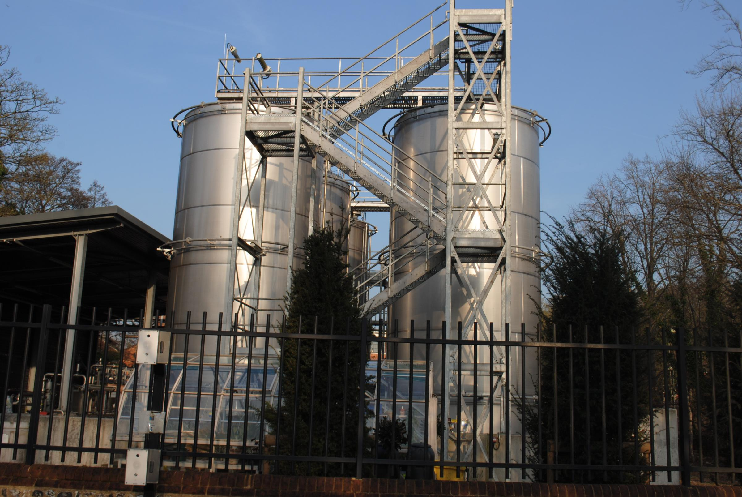 The tanks at the distillery opposite their house