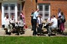 Networking: Members enjoy the music academy garden. NOP