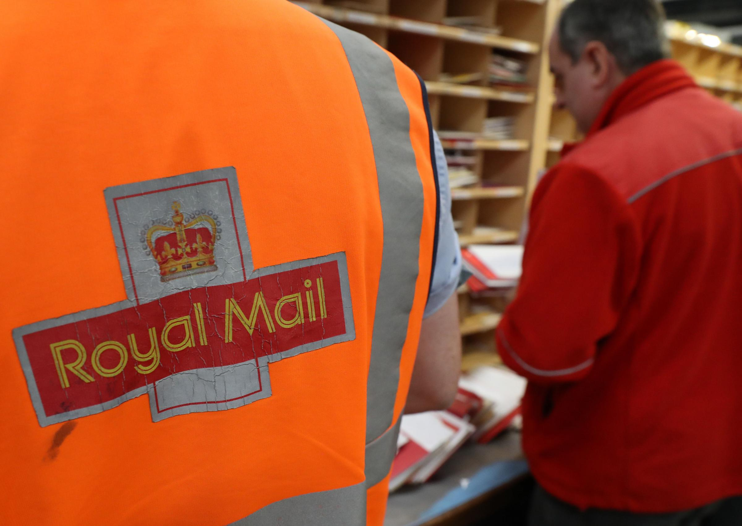 File photo dated 15/12/16 of Royal Mail workers at a sorting office. The result of a ballot for strikes by Royal Mail workers in a bitter dispute over pensions, pay and jobs will be announced on Tuesday. PRESS ASSOCIATION Photo. Issue date: Tuesday Octobe