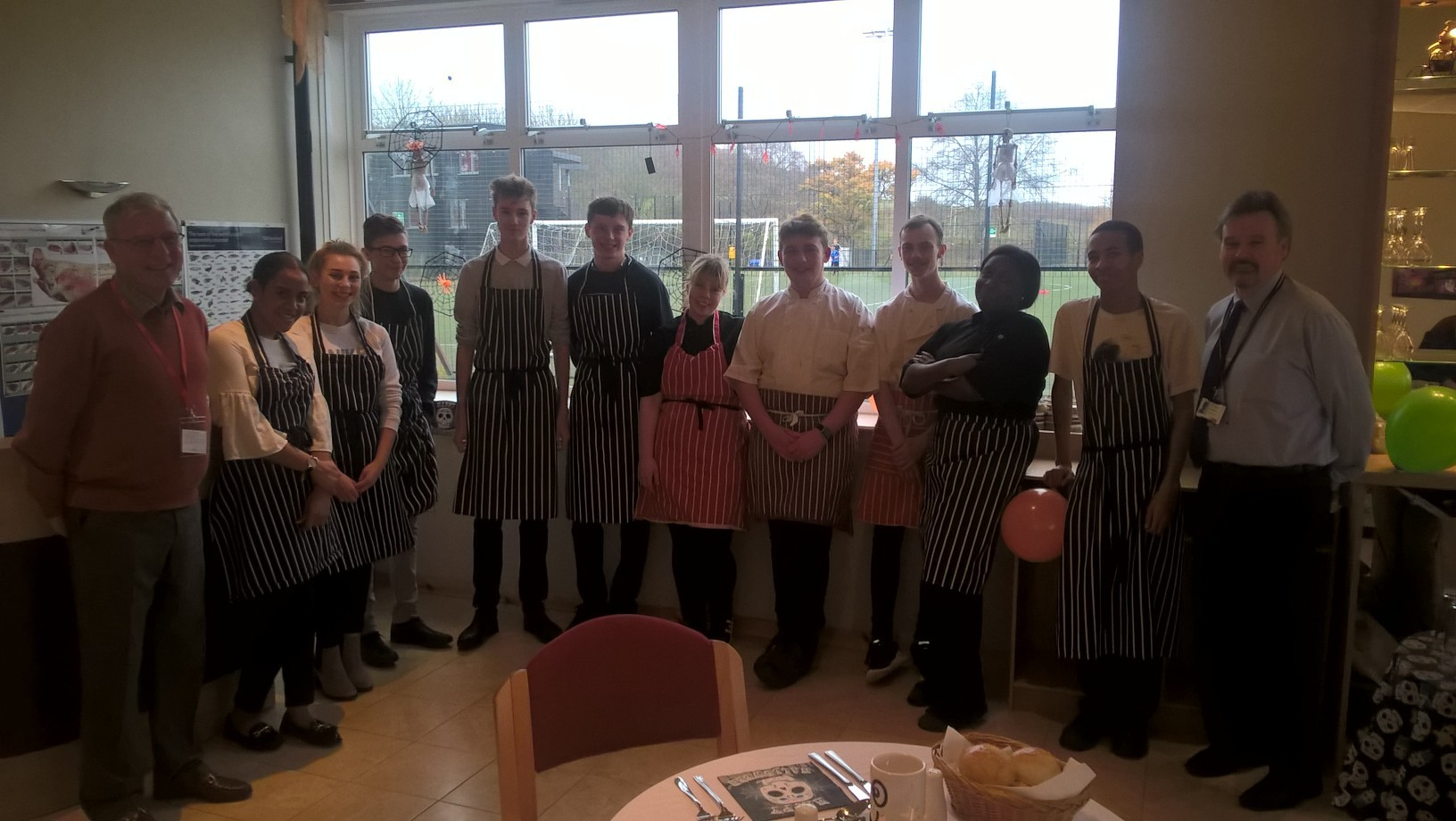 Cllr Chris Williams with students and professional chef teacher, Bruce McFarlane