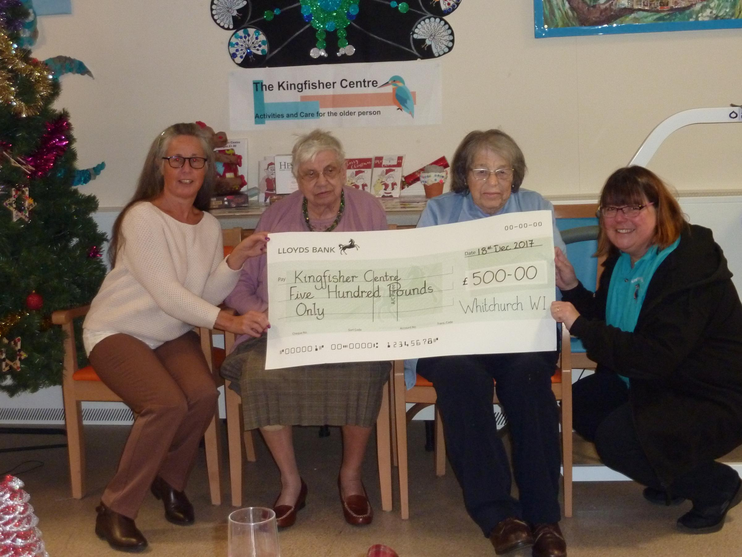 The photo shows Adele Gilchrist (President of Whitchurch WI) presenting a cheque to Audrey Ball, Mary Kinge and Nicola Smith of the Kingfisher Centre, Laverstoke.