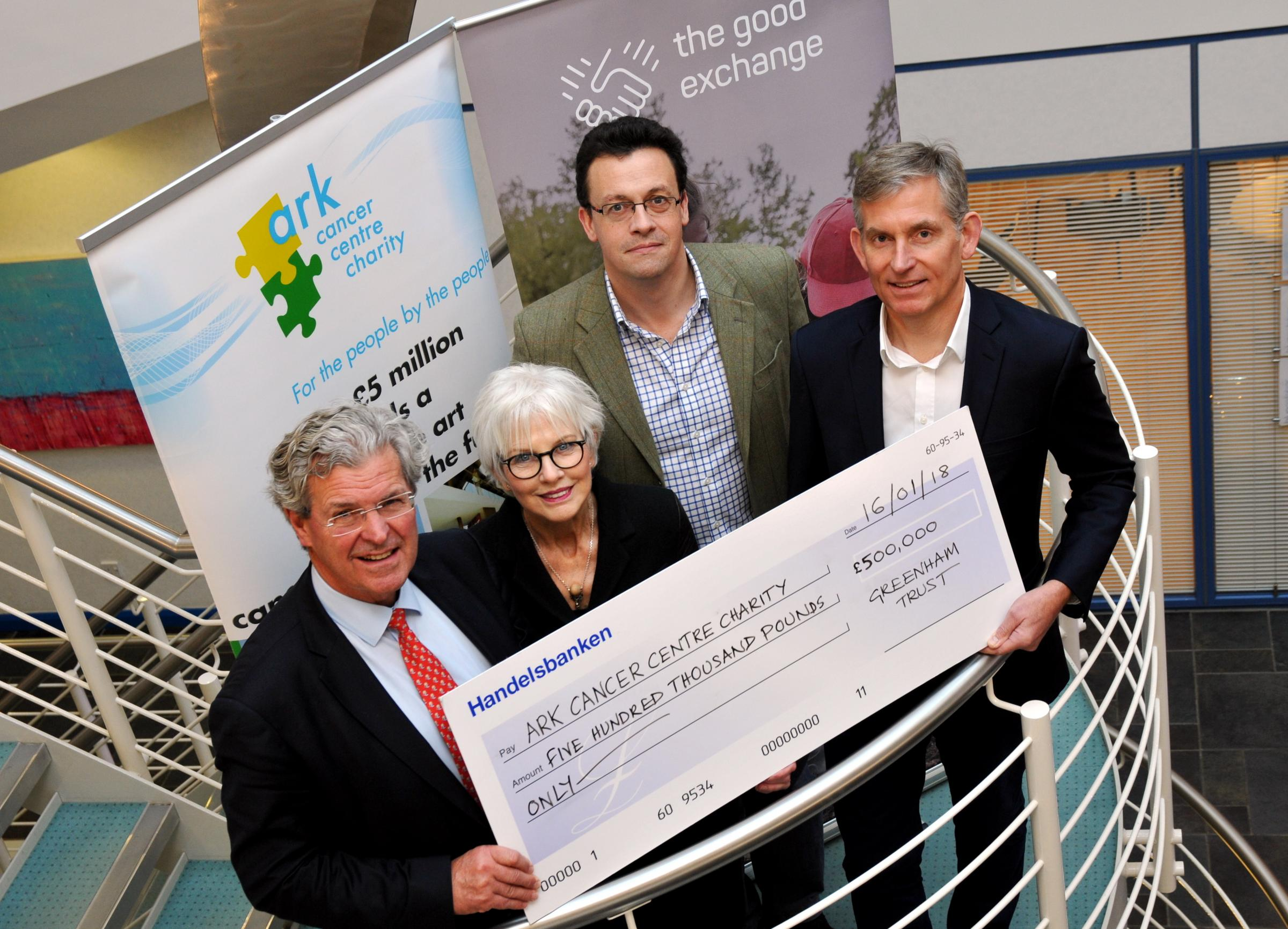 From left, Ark Cancer Centre Charity trustees Merv Rees and Sandra Fell are presented with the £500,000 match-funding cheque by Ed Gairdner, chief operating officer of The Good Exchange, and Chris Boulton, chief executive officer of Greenham Trust. Image