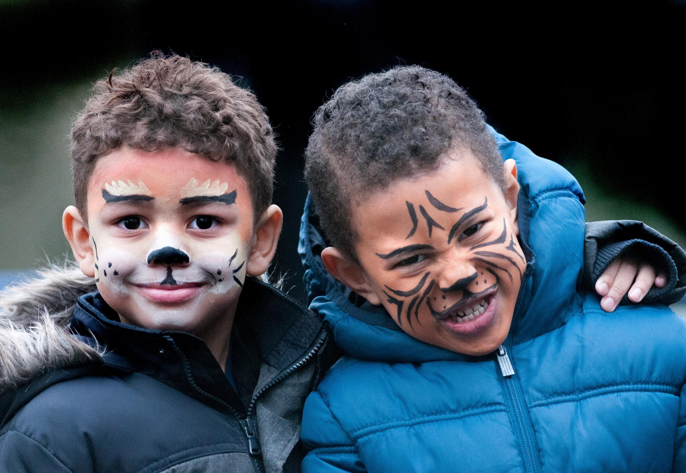 Lions & Tigers! 4 year old Trey Koko (left) and Lucian Jeffery (5) with their faces painted at The Portway Stadium. Image, Andy Brooks
