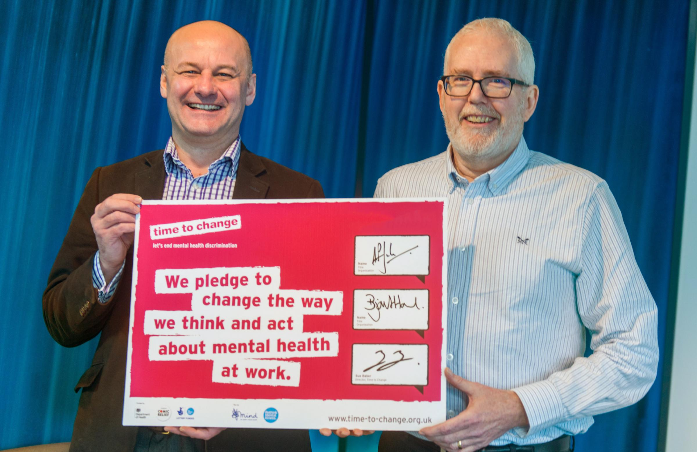 Left to right: group CEO Bjorn Howard and Andrew Jackson, group chair, signing our pledge
