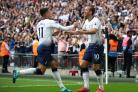 Harry Kane, right, celebrates scoring his first ever Premier League goal in August