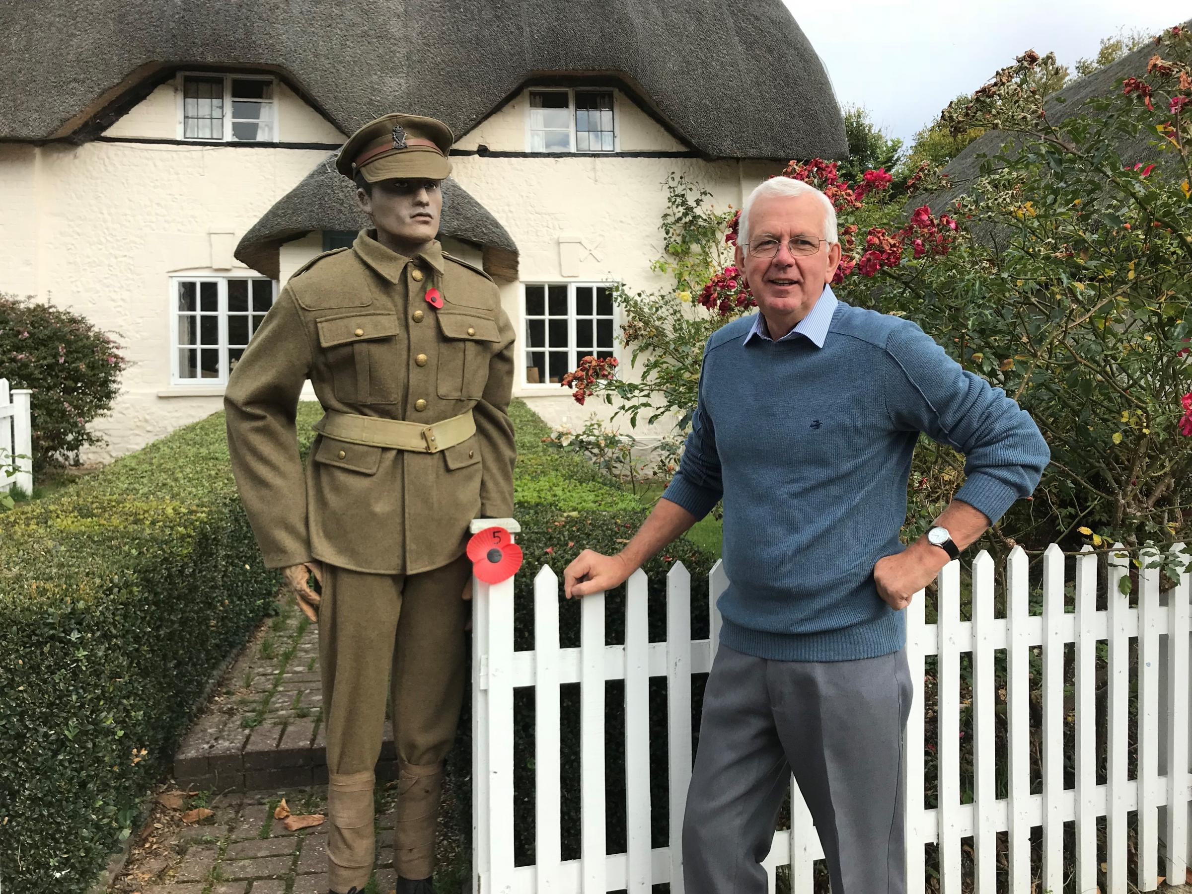 Rod Eggington, with a replica soldier, outside one of the houses on the poppy trail