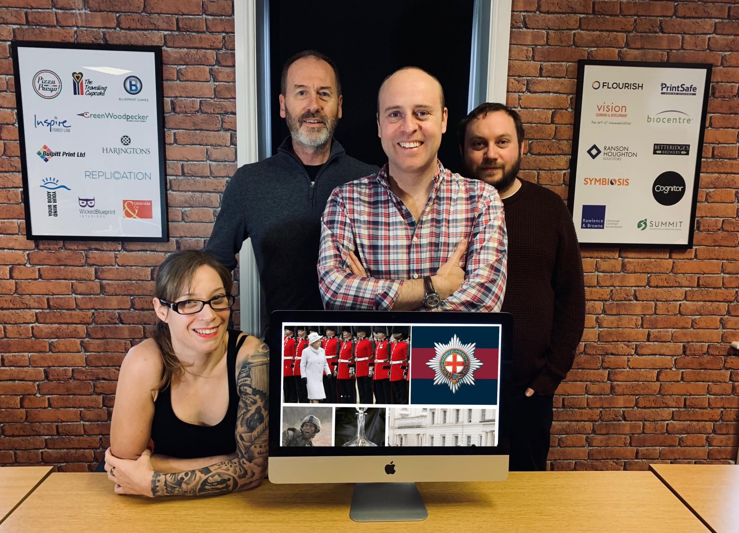 The Webkick team show off its work on the Coldstream Guards website