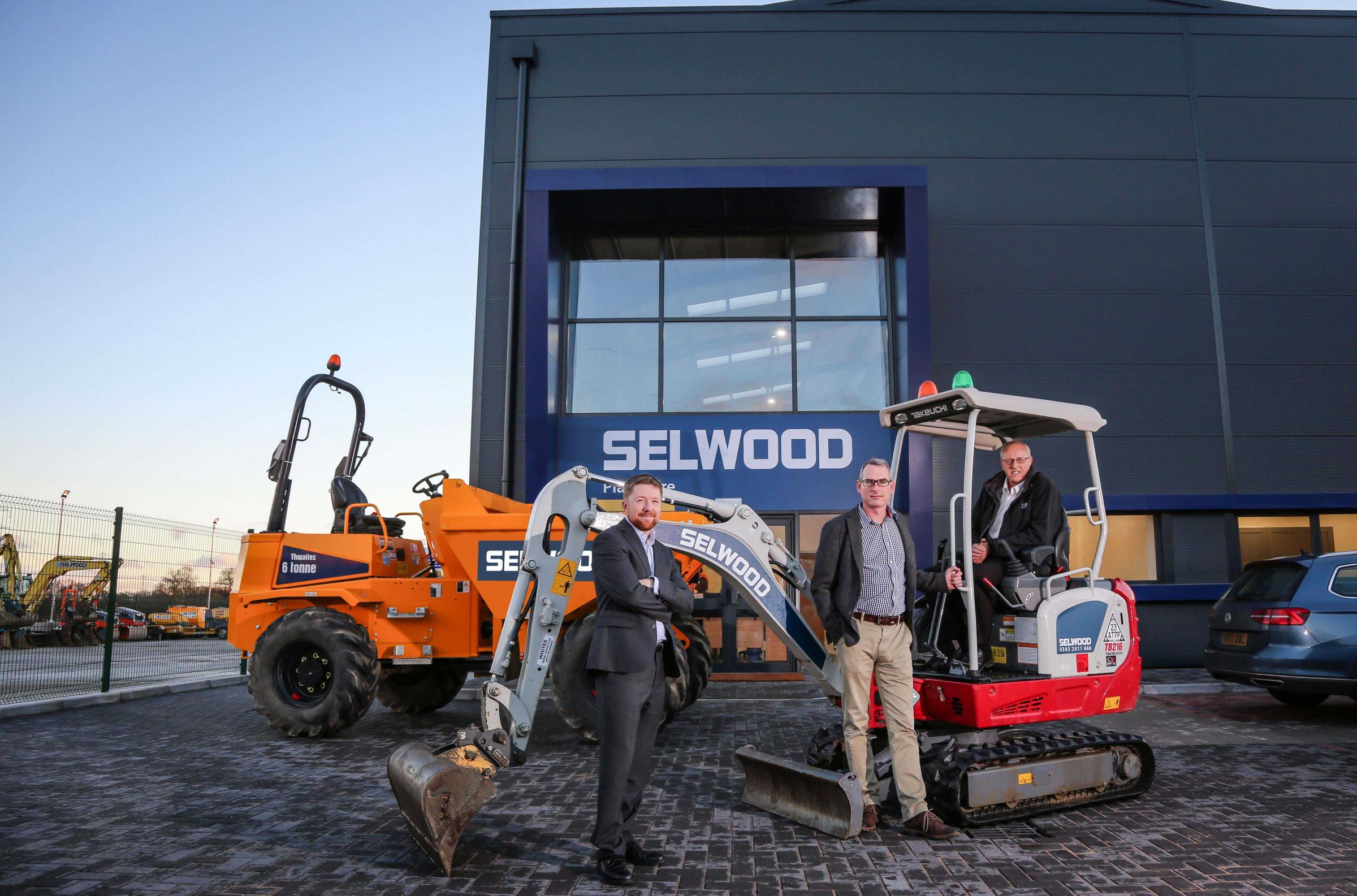 EXPANSION: Outside Selwood's new purpose-built Bournemouth plant hire branch are, from left, Russell Miller of commercial property consultancy Vail Williams, Tim Vincent, Selwood's commercial property manager, and branch manager Andy Killick. Va