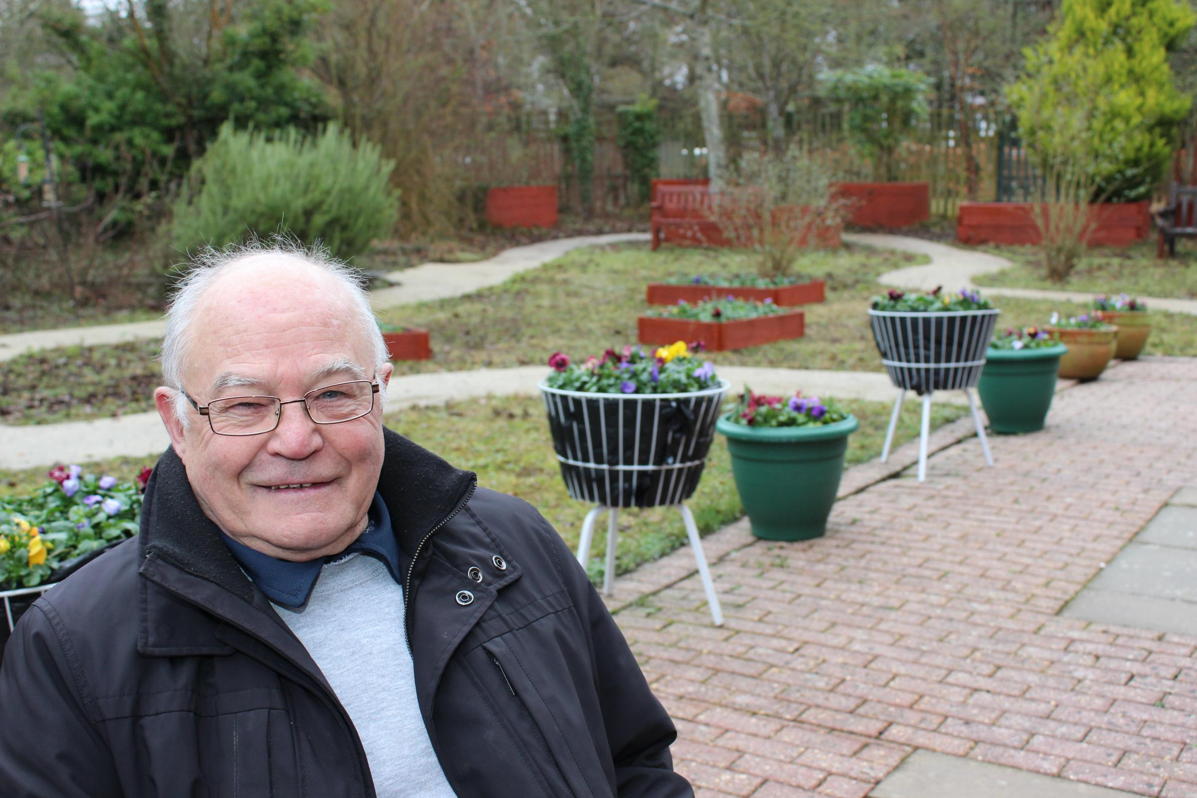 Jim Hanson in the garden he created at Andover War Memorial Hospital