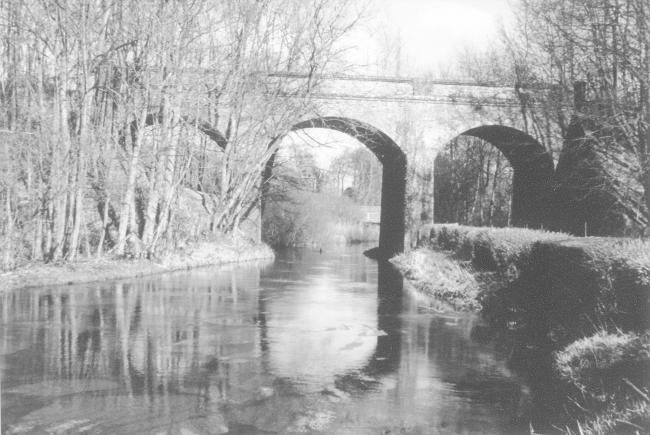 The Didcot, Newbury and Southampton Railway bridge at Tufton over the River Test looking downstream in the winter of 1974.