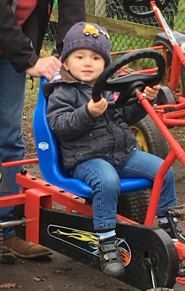 Atticus riding a go-cart at Finkley Down Farm
