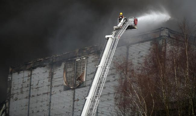Firefighters at the Ocado warehouse fire in February. Image: Andrew Matthews/PA