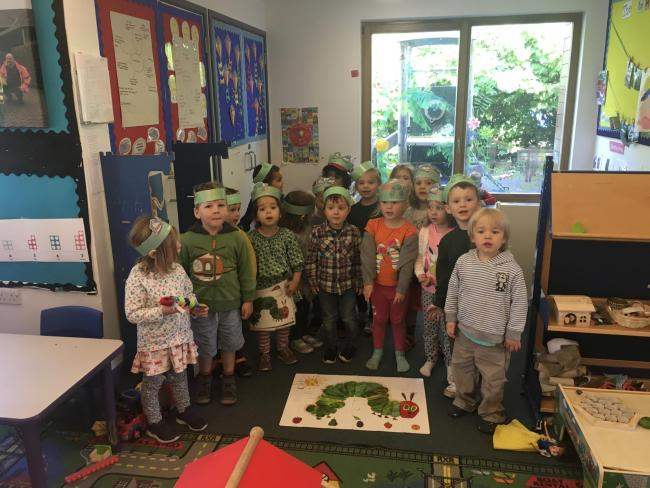 Youngsters at Longparish Little School celebrating the 50th birthday of the Very Hungry Caterpillar