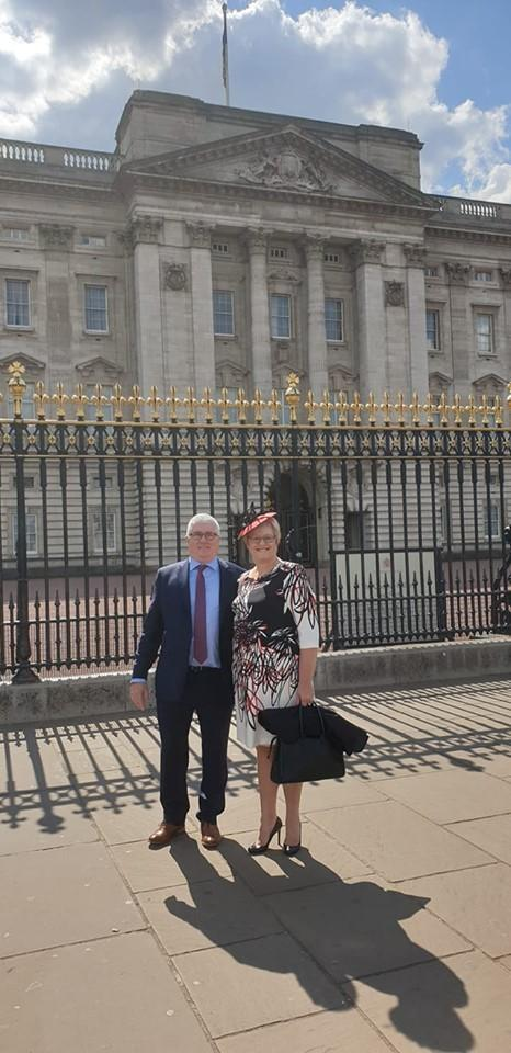 Phil and Terry Bishop outside Buckingham Palace